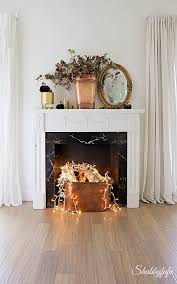 fake fireplace idea with string lights