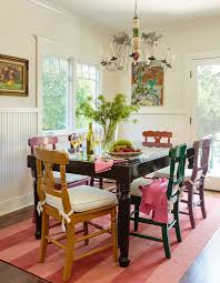 old painted chairs and table give the dining room a clical element design alison